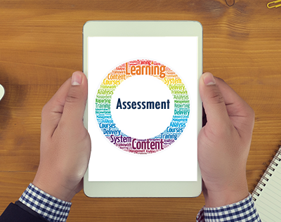 Word cloud of academic Assessment on an iPad screen