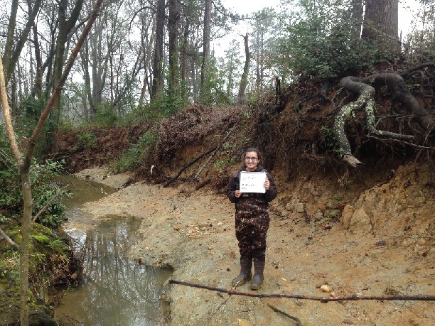 Beth conducting BEHI measurements in Parkerson Mill Creek at a badly eroding location