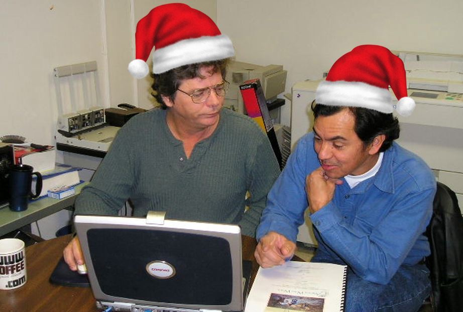 AWW's Santas - Jim Johnson and Sergio grinding through SQL, HTML and who knows what else!