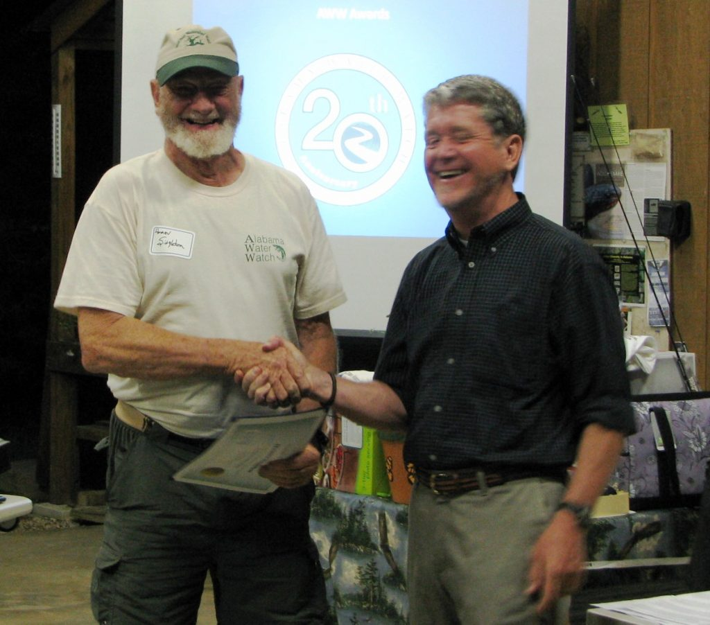 Homer receiving the AWW Trainer Of The Year Award from Dr. Deutsch in 2013.