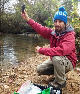 Stephen monitoring water chemistry at local stream near Gadsden.