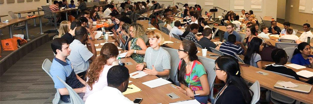 Students engaging in group discussion, an orientation activity.