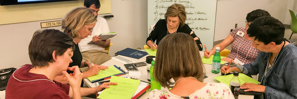 Faculty engaged in course redesign groupwork