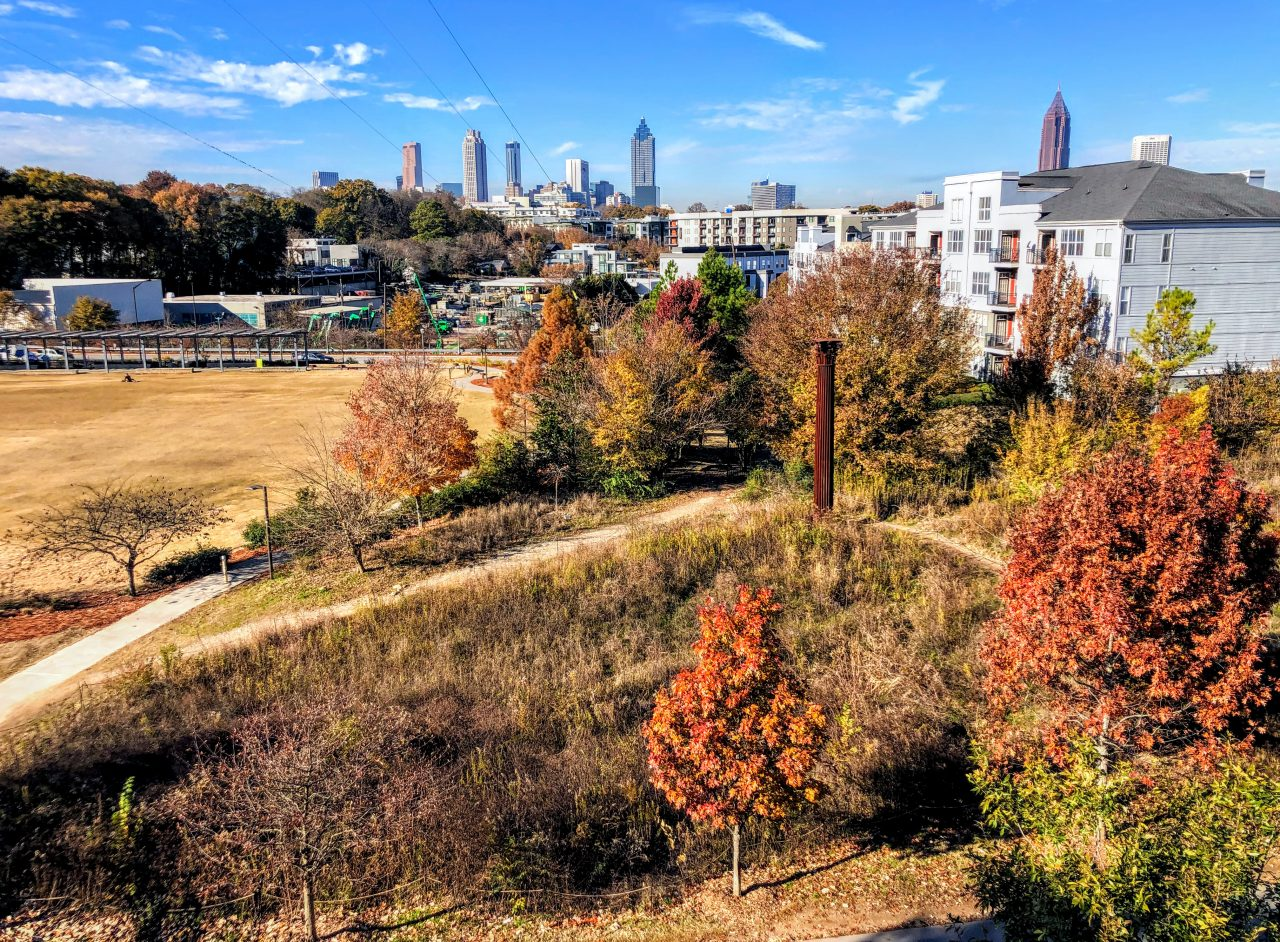 ATL skyline is in background of apartments and park