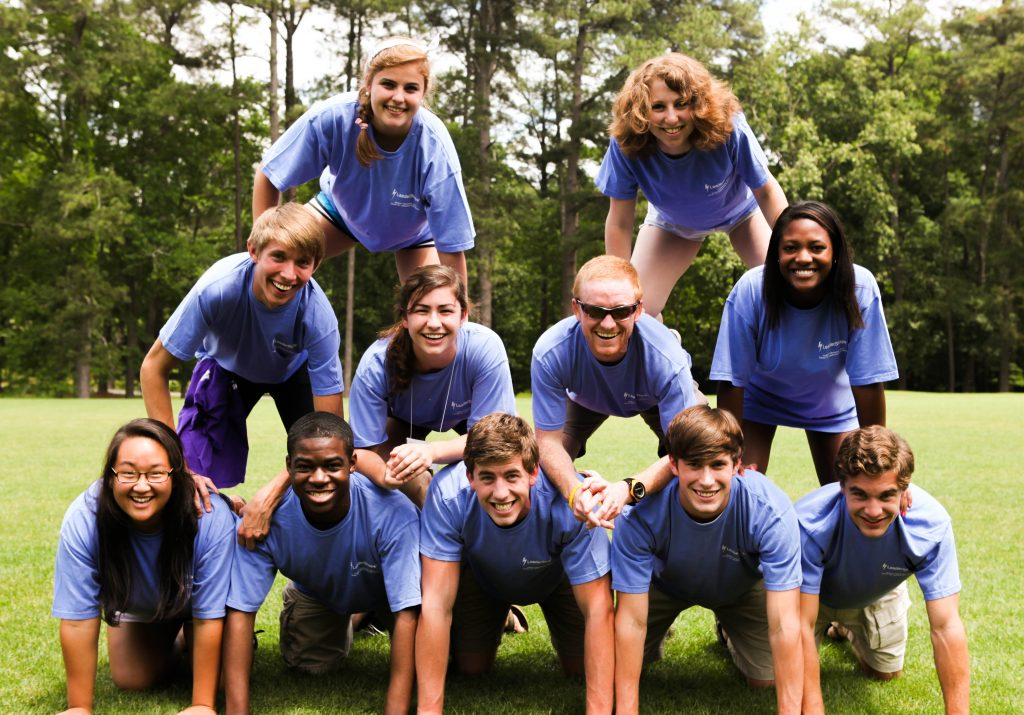 Photo of 11 students in a pyramid wearing LeaderShape t-shirts.