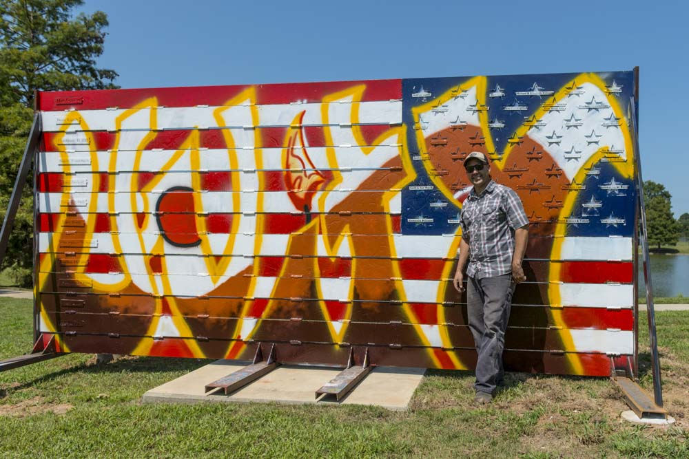 Alabama artist Ira Hill poses with his work, American Expressions