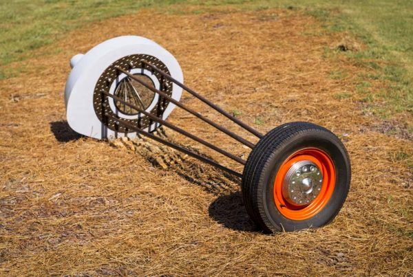 Ben Lock (North Carolina, b. 1980) Rubber Burner, 2011 Steel, chrome lugnuts, convex mirror, wheel, tire, chrome hubcap, gray primer, Chrysler Hemi Orange paint
