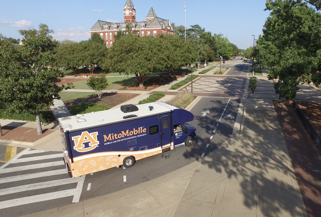 MitoMobile driving on Auburn University's campus with Samford Hall in the background