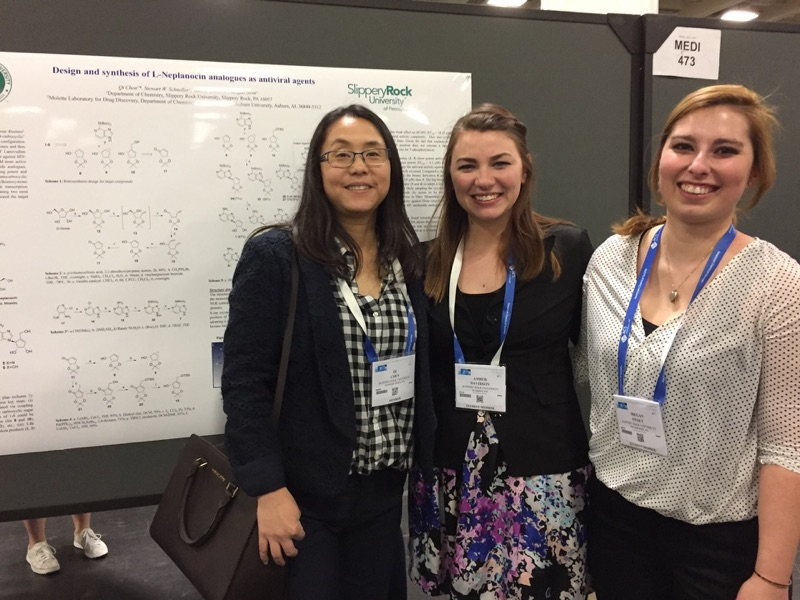 Qi Chen with students at ACS poster