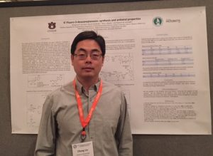 Picture of Chong Liu in front of his poster at the conference