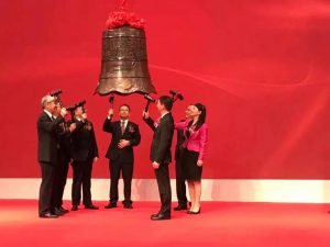 Minmin Yang ringing bell with PharmaBlock representatives