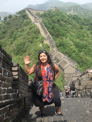 Dana Lashley on the Great Wall of China wearing an Auburn scarf