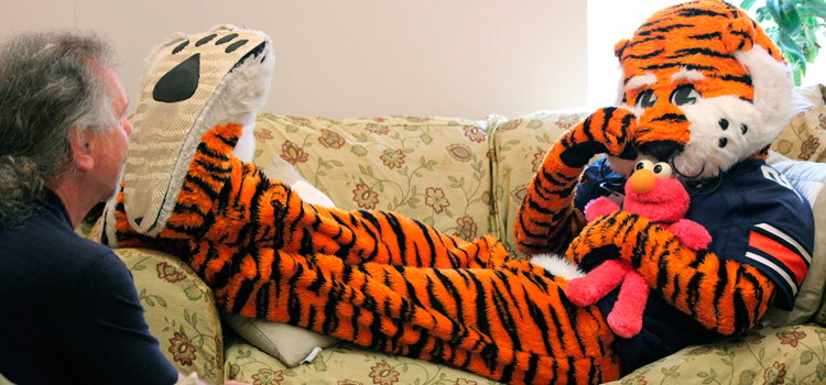 Aubie meets with the director, Dr. Hankes